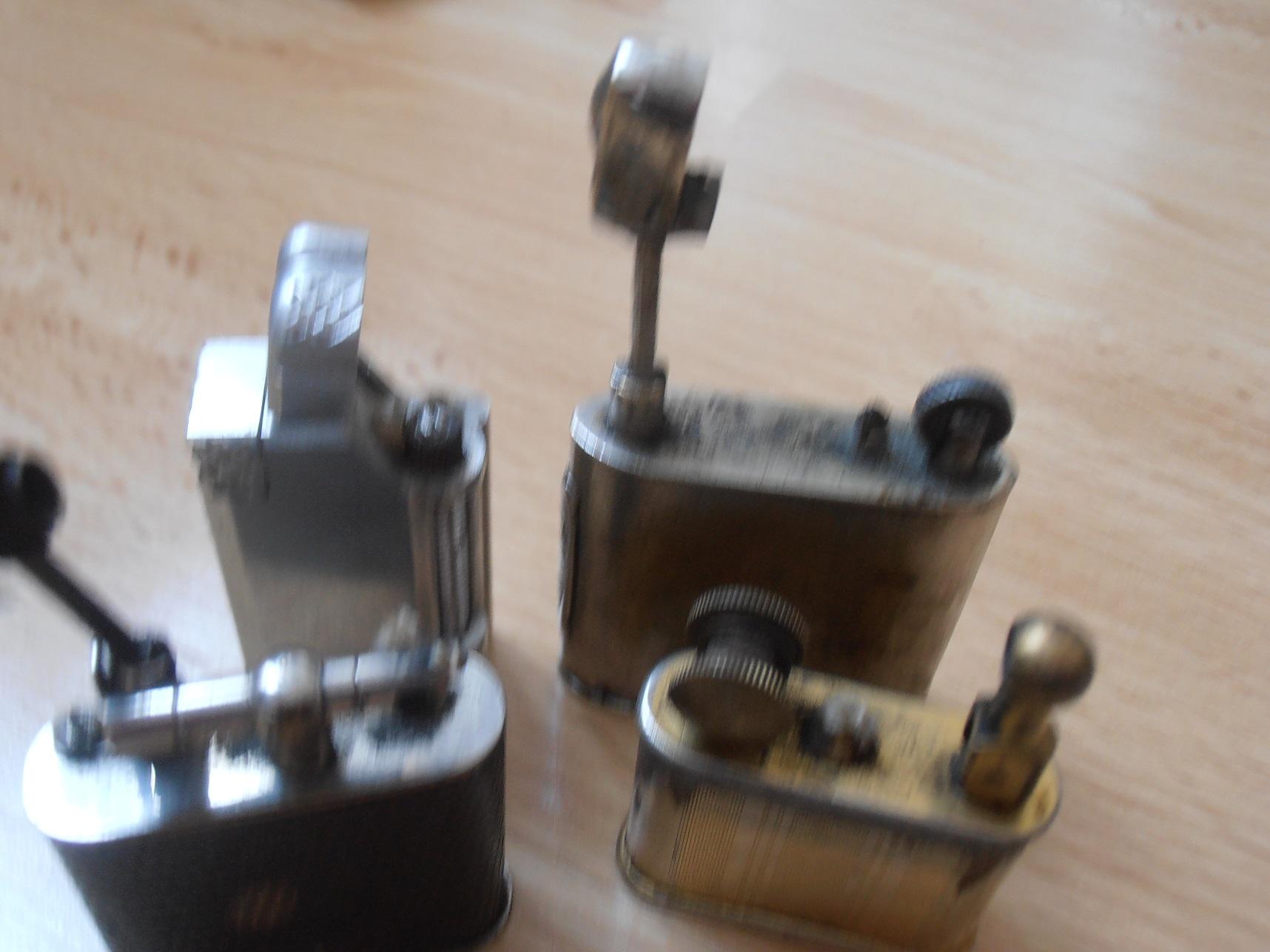 je rechercher aussi des briquet en l essence ancien , comme photo ci  dessous , dit   briquet bras levé http   image.poubelles.be P10122184.JPG 8debca426339